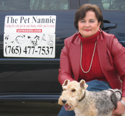 Betty with Rollie next to Pet Nannie car